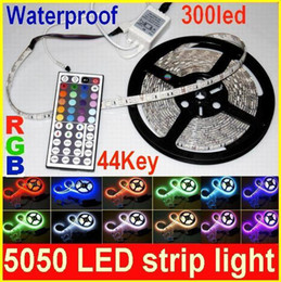 Wholesale Led Meter Roll - 5 meter roll SMD 5050 Waterproof RGB LED Flexible Strip light 300LED+ 44 key IR Remote controller DC12v led light strips