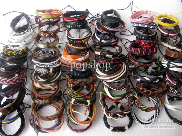 I lotti all'ingrosso liberi di trasporto hanno mescolato il regalo dei braccialetti di cuoio tribali etnici del polsino del Surfer del polsino