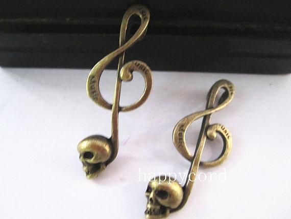 Cabeça de esqueleto de bronze antigo charme música pingente 41mmx15mm 20 pçs / lote