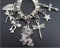 Wholesale Metal Dragon Bracelet - 140pcs lot Tibetan Silver Chinese Dragon Dragonfly Leaf Big Hole Charm Beads Fit European Bracelet 2013011704