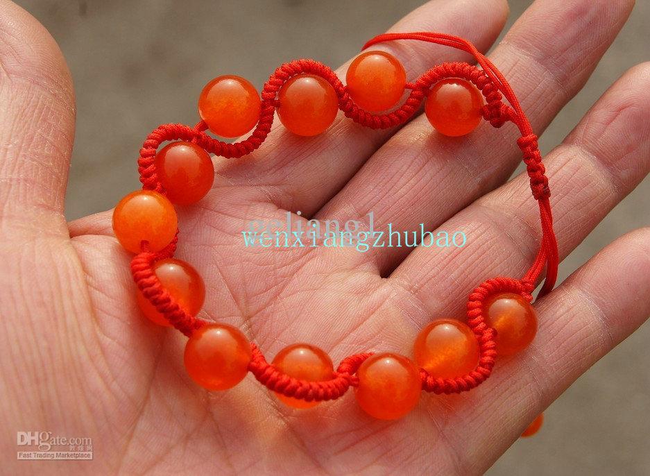 Cuentas redondas de jade de pura pulsera tejida a mano con forma de serpiente.