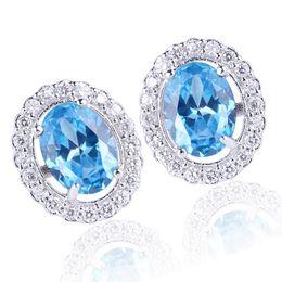 Wholesale Blue Topaz White Gold Earrings - Oval Shape Blue Topaz White Gold Finish Studs Piercing 925 Sterling Silver Earrings NAL E030