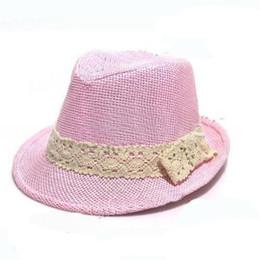 Sombrero de paja para bebé niño online-Sombrero Fedora de Paja para Niños Bebé Paja de Verano Sombrero de Vaquero Niños Niñas Sombreros de Paja de Bebé Bebé 10 unids