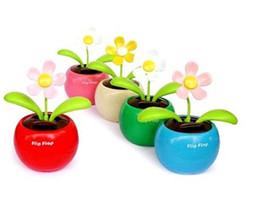 2013 moda 20pcs Magic Cute Flip Flap Swing Flor solar, verde, azul, rosa planta de juguete solar desde fabricantes