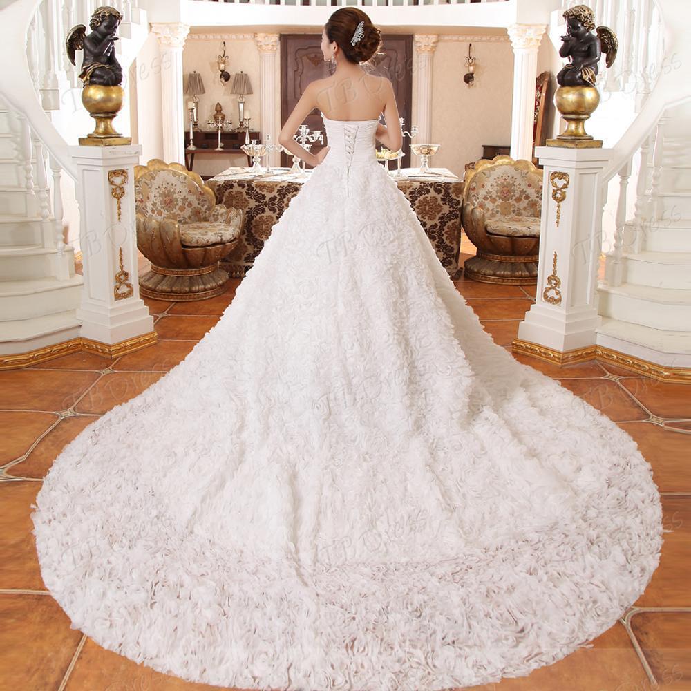 Aangepaste nieuwste glamoureuze a-lijn strapless kathedraal trein bloemen trouwjurk jurken