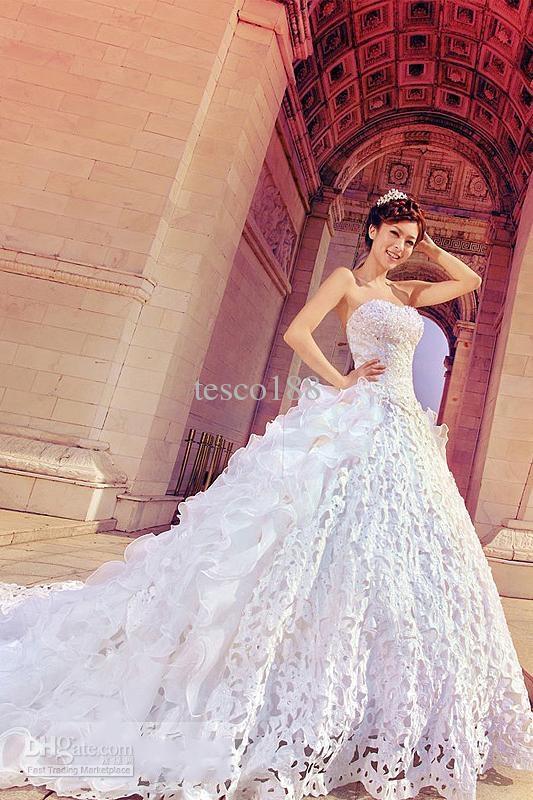 Aangepaste nieuwste A-lijn strapless kapel trein trouwjurk jurken