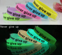 Unisex sport slogan - 100pcs Luminous NEVER GIVE UP Motivation Slogan Silicone Wristbands Men Women Rubber Band Sports Luminated Bracelets Fashion Jelly Bangle