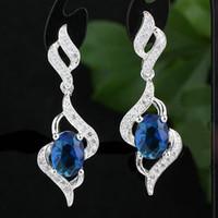 brincos de safira azul esterlina venda por atacado-As mulheres Sapphire Blue Oval Real Sterling 925 Silver Dangle Brincos NAL E085