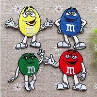 karikatur applikationen bestickt großhandel-Großhandel ~ Mixed 4 Farbe Cartoon MM bestickt Eisen auf Applique Patch Kids Patch