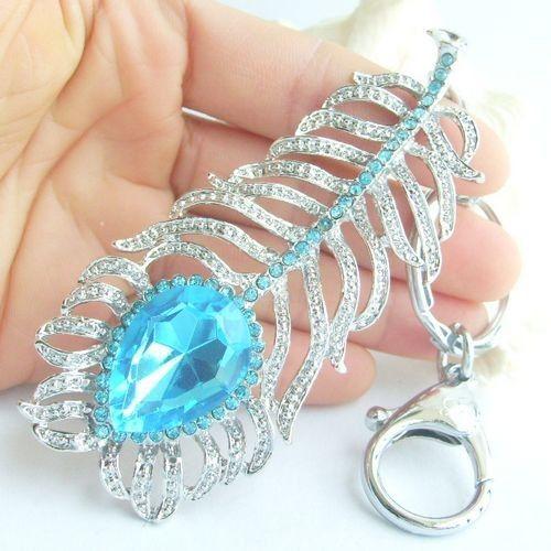 Joli pendentif de plume de paon avec cristaux de strass bleus KYS05102C2