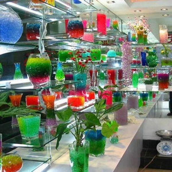 Nouvelle usine magique de cristal de terre de boue perles de perle de gelée de cristal de sol de boule de cristal Mélanger le paquet de couleurs au détail la livraison gratuite 20 sacs / douzaine