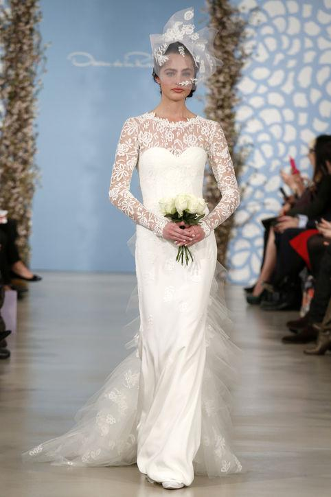 Long sleeve lace applique ruffled tulle mermaid wedding for How much do oscar de la renta wedding dresses cost