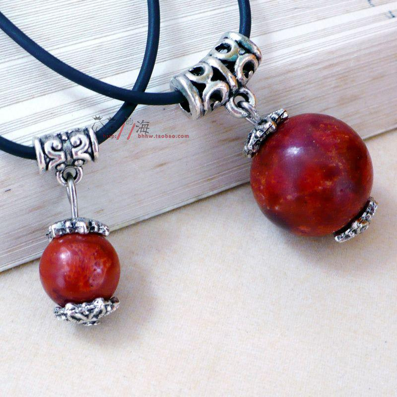 history origin coral wrapped red gemstone and wire silver of pendant