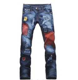 Jeans sottili tagliati mens online-Jeans uomo moda strappata jeans strappati bucati gamba dritta taglio slim