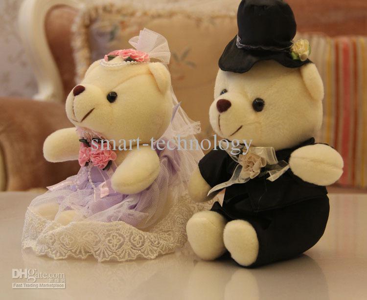 el oso de peluche del juguete del oso del peluche que se sienta lleva a amantes en el vestido de boda, juguete del oso para el regalo de boda