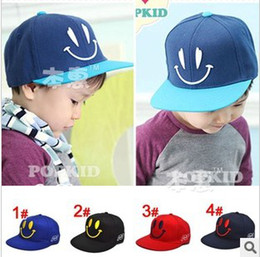 Wholesale Children s caps smiling face kid s baseball hats cotton embroidery cartoon children s hats