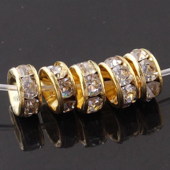 Freies Verschiffen! Gold überzog eine 8mm flache seitliche Rhinestone-Rondell-Distanzscheiben-Korne für fashione Entdeckungen