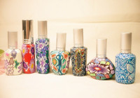 Wholesale Pottery Bottles - 15MLTravel Perfume Bottle Scent Atomizer Spray Refillable Empty Makeup Aftershave Colored Pottery 7Design Bottle Best Gifts HK Post Free