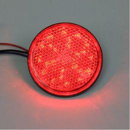 Красный светодиодный мотоцикл онлайн-Красный LED красный лен отражатели круглый стоп-сигнал универсальный мотоцикл автомобиль грузовик