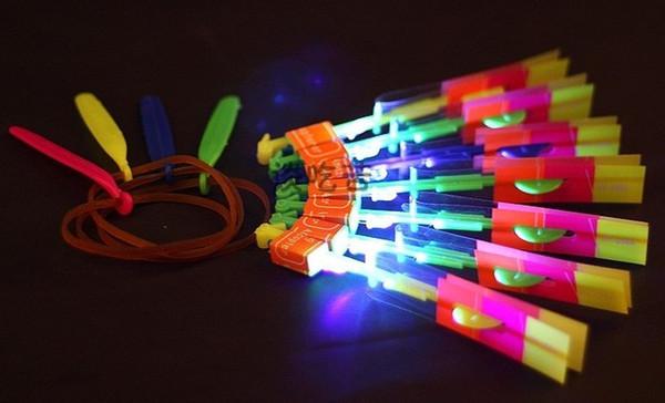 100pcs Christmas Gift LED amazing arrow Flying helicopter umbrella kids toys Space UFO,LED Lighte Up Toys