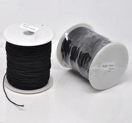Canada JLB 1mm 120 m / lot En Gros De Mode Bijoux Conclusions Noir Élastique Coton Couvert Fil Cordons DIY Matériaux Accessoires Livraison gratuite Offre