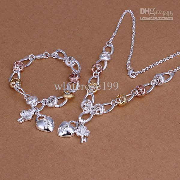 Al por mayor - el precio más bajo regalo de Navidad de plata de ley 925 Collar de moda + Pendientes conjunto QS006
