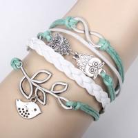 leather lucky charm bracelets großhandel-20pcs Infinity, Eulen Glück Branch / Leaf und Lovely Bird Charm Armband in Silber - Mint Green Wax Cords und Leder Braid