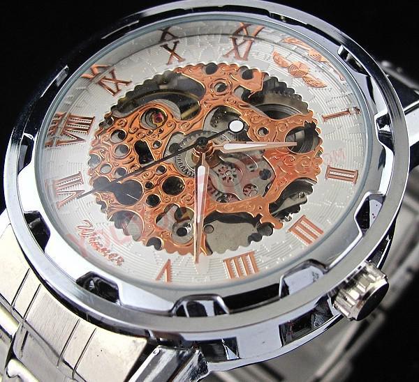 ファッション勝者のレトロなヴィンテージのステンレス鋼のスケルトンの機械式ウォッチのためのマンゴの自動機械腕時計時計