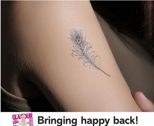 tatouage plume de paon pied. Black Bedroom Furniture Sets. Home Design Ideas