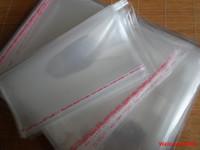 ingrosso sigillo di plastica per abiti-100 pz 24 * 34 cm buona qualità OPP sacchetto di gioielli libro / vestiti sacchetto di imballaggio autoadesivo sigillo trasparente sacchetto di plastica trasparente