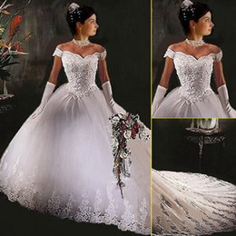 Wholesale Dress Autumn Hot - 2016 New Royal Wedding Dresses Off Shoulder Appliques Backless A Line Chapel Train Tulle Glamorous Bridal Gowns Hot Customed In White Ivory