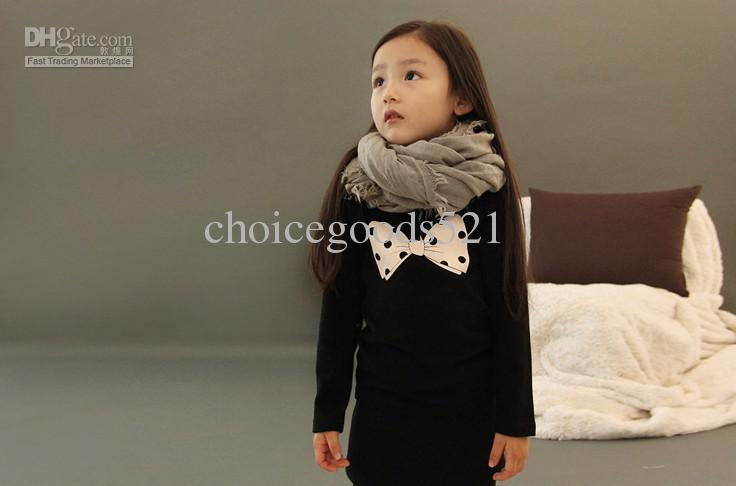 Wholesale -Girls autumn models wild temperament simple bow bottoming dress princess skirt Long T shirt bag winter dot baby dress kids skirt