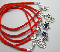 cuerdas de hombres al por mayor-Artículos calientes 100 piezas de mano de Cabalá mixta encantos de cadena roja pulseras de buena suerte Hombres y mujeres pulsera afortunada