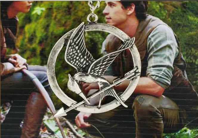 Al por mayor - - Los collares de los juegos del hambre inspiraron a Mockingjay y el collar pendiente de la flecha