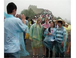 Wholesale Disposable Ponchos - New Travel Essentials Disposable PE Raincoat hat rain Poncho manufacturer random color 50pcs