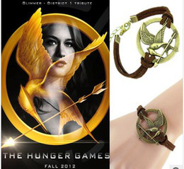 Wholesale Hunger Games Charms - European and American big retro Hunger Games Bracelet street shooting star minimalist birds with bows mock leather bracelet free shipping