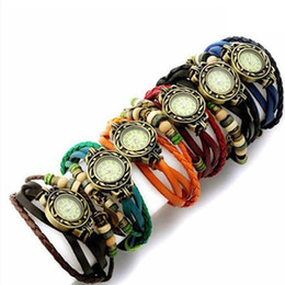 Big Promotion! 10pcs / lot Cuarzo retro tejido de moda envolver alrededor de la pulsera de cuero del árbol de las mujeres hoja verde reloj de la muchacha + 7colors desde fabricantes