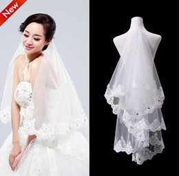 Wholesale Elbow Length Crystal Edged Veil - Top Quality Elegant 2T White Ivory Crystal Beaded Lace Wedding Veils Bridal Veils With Lace Wedding Favor Veils Cheap In Stock Free Shipping