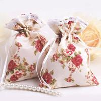 Wholesale European Flowers Favors - 9.5*14cm European Cute Flower Painting Cloth Candy Bag Fashion Color Punch Party Favors 50pcs lot CK091