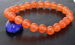 Pierres de jade rondes en Ligne-Perles de charme pierres précieuses forme ronde 8mm de couleur orange Jade Stretch Bracelet Les bijoux de la fille de la mode Madame Nouvelle Expédition gratuite.