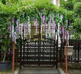 Künstliche lila wisteria reben online-Großhandel - Brandneu Gelb / Blau / lila / weiß Simulation Blume Künstliche Seide Blume Glyzinien Reben Douhua Hochzeit Dekoration