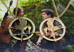 $enCountryForm.capitalKeyWord Canada - 2014 Hot In Vintage Style Hunger Games Mockingjay Pendant Necklace 4 Colors 12pcs lot