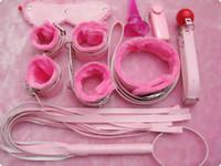 pinces à tétine rose achat en gros de-Meilleure valeur BDSM Bondage Gear Kit 7 pièces manchettes Gags pinces à tétons fouets collier Anal plug etc couleur rose Fetish Sex Toys B0301001