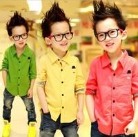 ingrosso camicie in cotone giallo a manica lunga-Magliette dei bambini della maglietta brandnew 100% del cotone giallo / rosso / verde del lungo-manicotto brandnew per i vestiti di modo dei ragazzi Trasporto libero