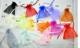 ¡Bolsas de cordón pequeñas! Venta al por mayor 100pcs / lot 20Colors Mixed Organza Jewelry Gift Pouch Bags 9x12cm Bolsa de cordón Envío gratis desde fabricantes