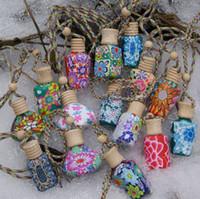 ingrosso bottiglie di profumo di ceramica-15 ml Car hang decoration ceramic Polymer clay essence oil Bottiglia di profumo Hang rope bottle vuota