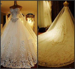 Wholesale Luxury Crystal A Line Wedding Dresses Lace Cathedral Lace up Back Bridal Gowns Sweetheart Appliques Beaded Garden Free Sets Free Veil