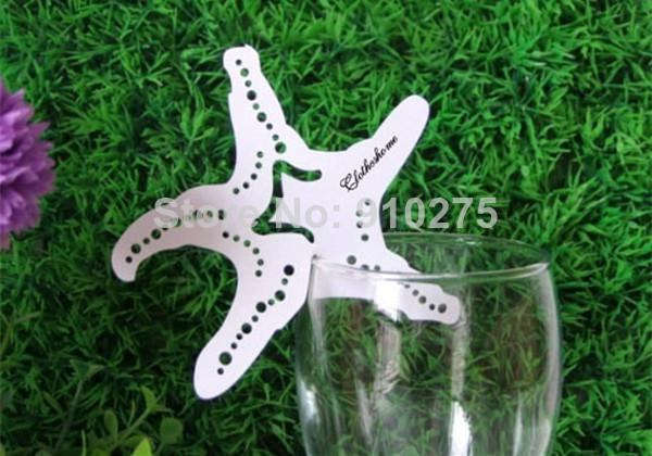 laser cut beach themed starfish wine glass place cards wedding table