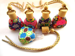 Wholesale Beautiful Perfume Bottles Wholesale - 2014 new Style High quality clay car perfume pendant ornaments car perfume car perfume pendant jewelry Beautiful Glass Essential Oil Bottle