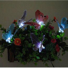 La nuova lampada solare del prato inglese di festival delle luci della farfalla a fibra ottica infiammata del LED per fuori porta la decorazione del giardino di nozze di Natale da farfalle decorazioni da giardino fornitori